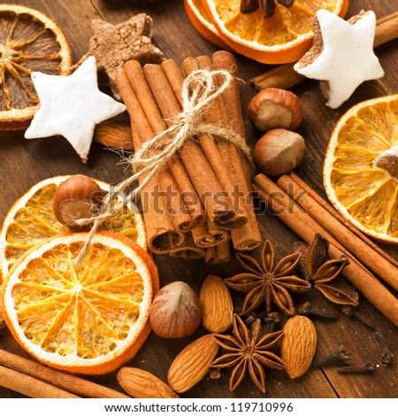 Christmas spices, cookies, nuts and fruits. Shallow dof. - stock photo