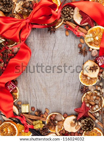 Christmas spices with dry orange and apple slices in frame with free space for text - stock photo
