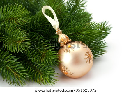 Christmas spruce sprigs and beautiful shiny ball isolated on white background - stock photo