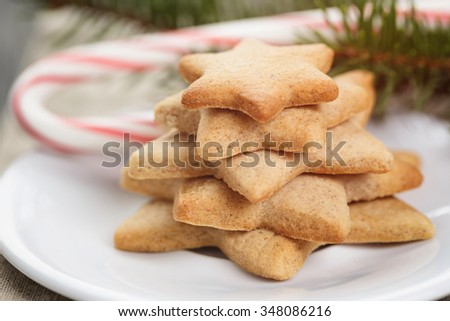 christmas star cookies on plate, vintage toned photo - stock photo