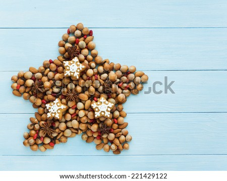 Christmas star made of nuts, berries and anise. Viewed from above. - stock photo