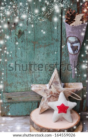 Christmas star over wooden background / Vintage christmas card - stock photo