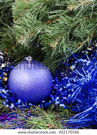 Christmas still life - Christmas ball, tinsel on Xmas tree background - stock photo