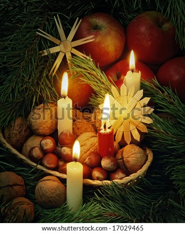 christmas still life with an apples in basket and candles - stock photo