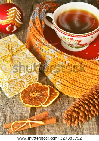 Christmas still life with cup of tea, orange slices and cinnamon, Happy New Year - stock photo