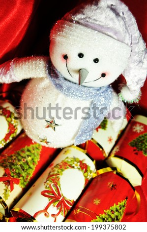 Christmas still-life with snowman and crackers  - stock photo