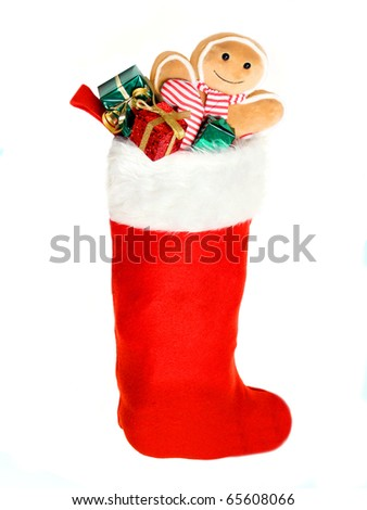 Christmas stocking filled with gifts and toys - stock photo
