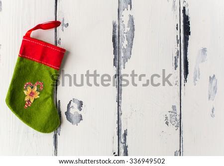 Christmas Stocking on white vintage wooden background - stock photo