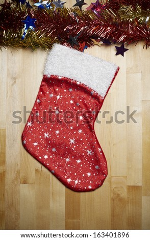 Christmas stocking with nostalgic vintage toy decoration over wooden background - stock photo