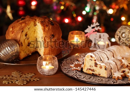 Christmas stollen, panettone, cookies and decorations. - stock photo