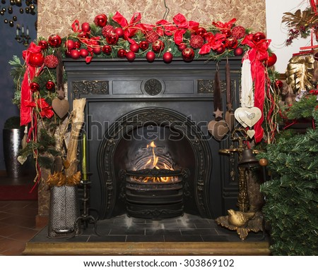 Christmas Stone fireplace with decorations, red and green Czech republic - stock photo