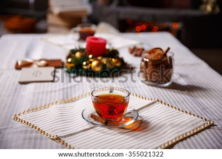 christmas stuff. shot made with shallow depth of field. selective focus. a cup of tea. - stock photo