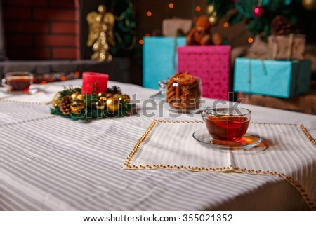 christmas stuff. shot made with shallow depth of field. selective focus. tea. candle. - stock photo