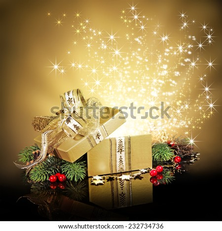 Christmas surprise gift box or present, exploding with glitters and stars against a festive holiday background - stock photo