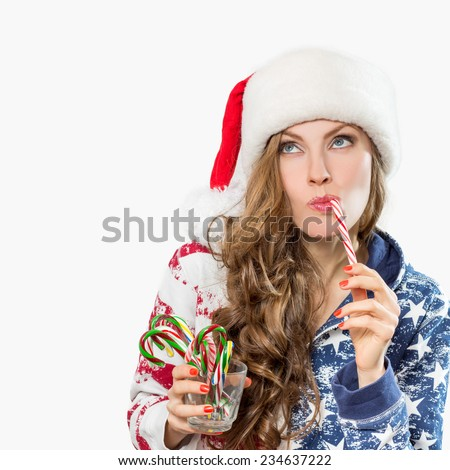 Christmas surprised winter woman. Funny santa claus woman portrait looking up.  Emotions
