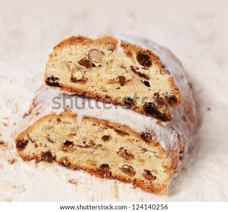 "Christmas sweet cut ""log"" in the background floured wooden board"