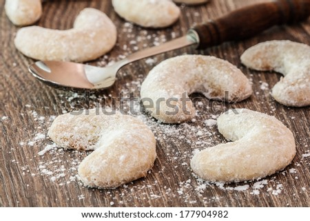 Christmas sweet rolls on brown wooden background with spoon - stock photo