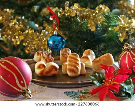 Christmas sweets by a decorated tree - stock photo