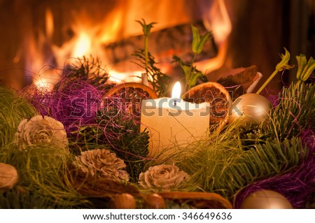 Christmas table decoration in front of fireplace.