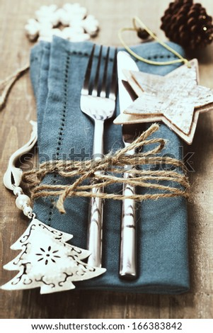 Christmas table place setting with christmas decorations - stock photo