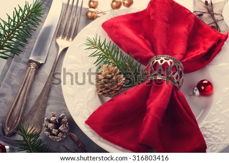 Christmas table place setting with christmas decorations. Christmas menu concept. Retro style toned. - stock photo