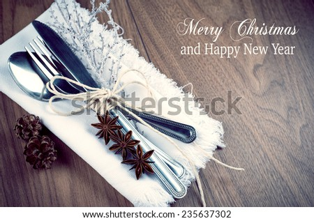 Christmas table setting, christmas menu concept in silver, brown and white color tone on wooden table with copy text space - stock photo