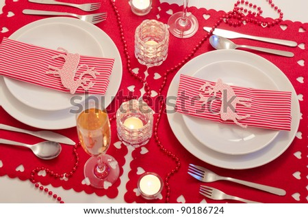 Christmas table setting in red and white - stock photo