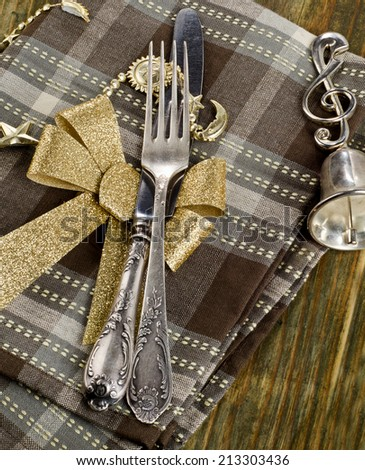 Christmas table setting  on a wooden table.