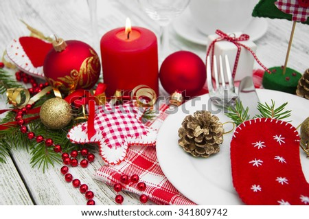 Christmas table setting with christmas decorations. - stock photo
