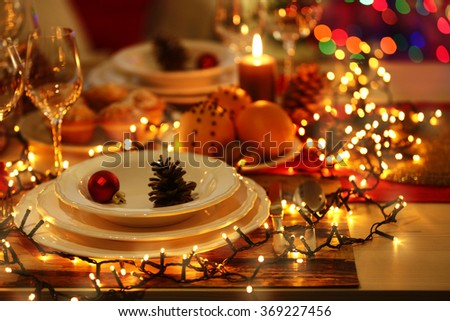 Christmas table setting with holiday decorations