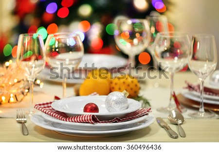 Christmas table setting with holiday decorations background