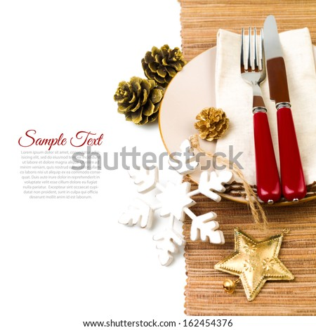 Christmas table setting with plate, kine, fork and decorations
