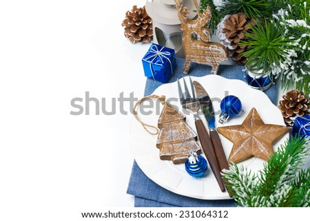 Christmas table setting with wooden decorations and spruce branches, isolated on white - stock photo