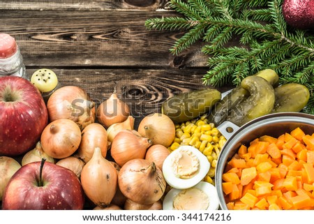 Christmas table with christmas tree, christmas bauble and vegetables. - stock photo