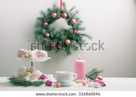 Christmas table with cup of coffee and dessert - stock photo