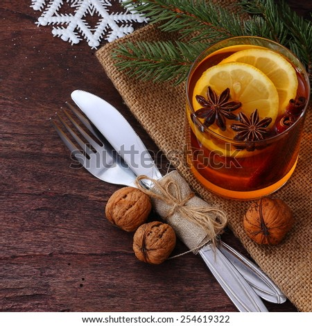 Christmas table with cutlery and aromatic tea - stock photo