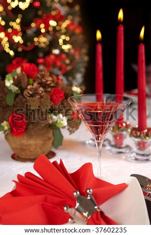 Christmas table with red napkins and candles - stock photo