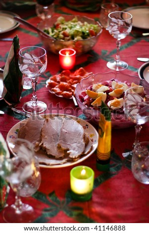 Christmas table with roasted pork on the plate - stock photo