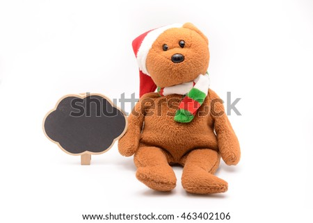 Christmas teddy bear with a small blackboard for writing juxtapose white background.