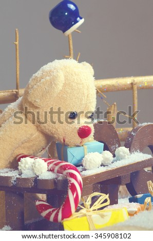 Christmas teddy bear with clay pot and candy cane. Filter - stock photo