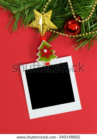 Christmas theme photo frame over red background