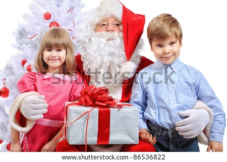 Christmas theme: Santa Claus and children having a fun. Isolated over white background.