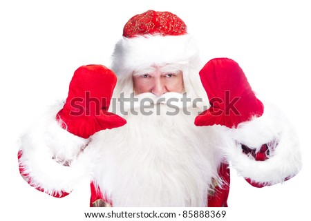 Christmas theme: Santa Claus bowing something from his arms - stock photo