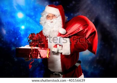 Christmas theme: Santa  gifts, snowy design. - stock photo