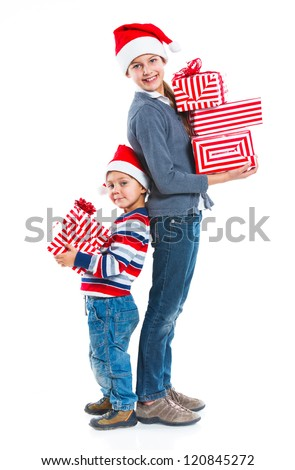 Christmas theme - Smiling little boy and his sister in Santa's hat with gift box, isolated on white - stock photo