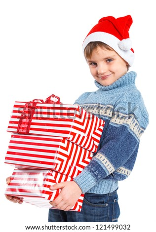 Christmas theme - Smiling little boy in Santa's hat with gift box, isolated on white - stock photo