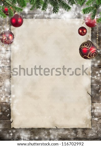 Christmas theme with blank paper on wooden planks - stock photo