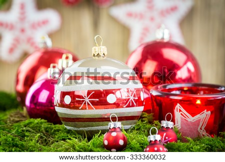 Christmas Themed Background Image with Red and Silver Decorations - Festive Holiday Balls on Lush Greenery - stock photo