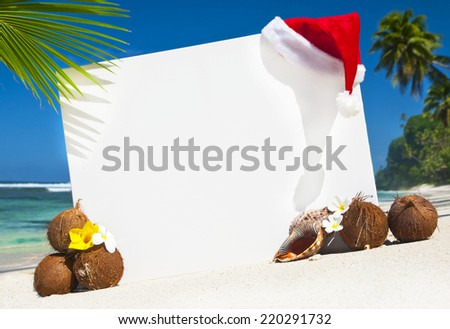 Christmas themed copy space on the beach. - stock photo