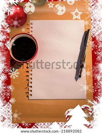 Christmas themed frame against overhead of graph paper coffee and pen